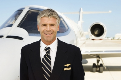 Pilot in Front of Private Jet --- Image by © Royalty-Free/Corbis